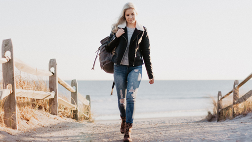 lady walking on beach thinking fear of the unknown is stupid