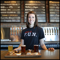 girl bartender with beers image
